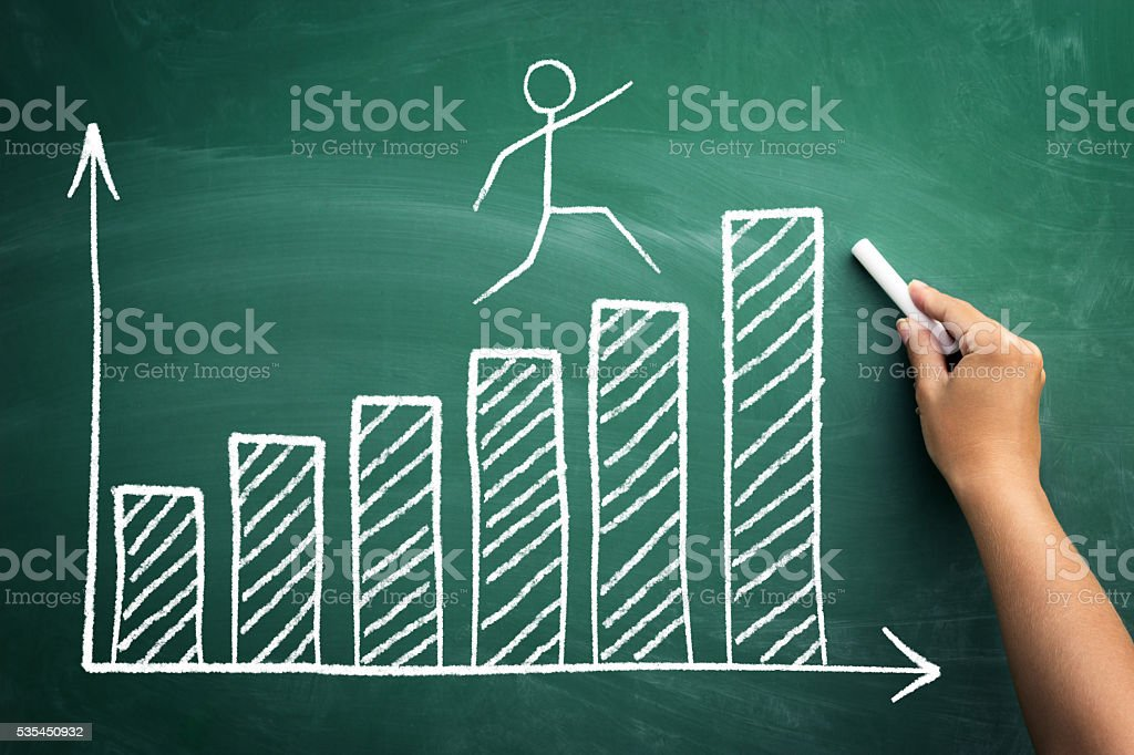 Stickman jumping on the diagram of success stock photo