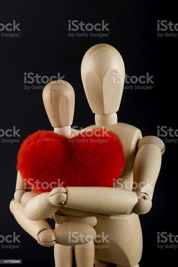 Stickmen holding his child and a heart stock photo