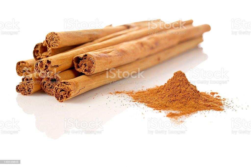 Sticks and powder of cinnamon royalty-free stock photo