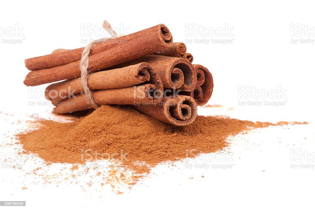 Sticks and powder of cinnamon stock photo