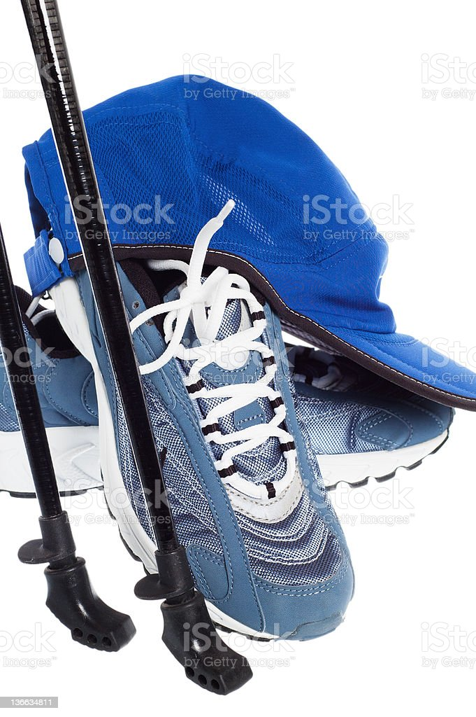 sticks for Nordic walking and  sports shoes royalty-free stock photo