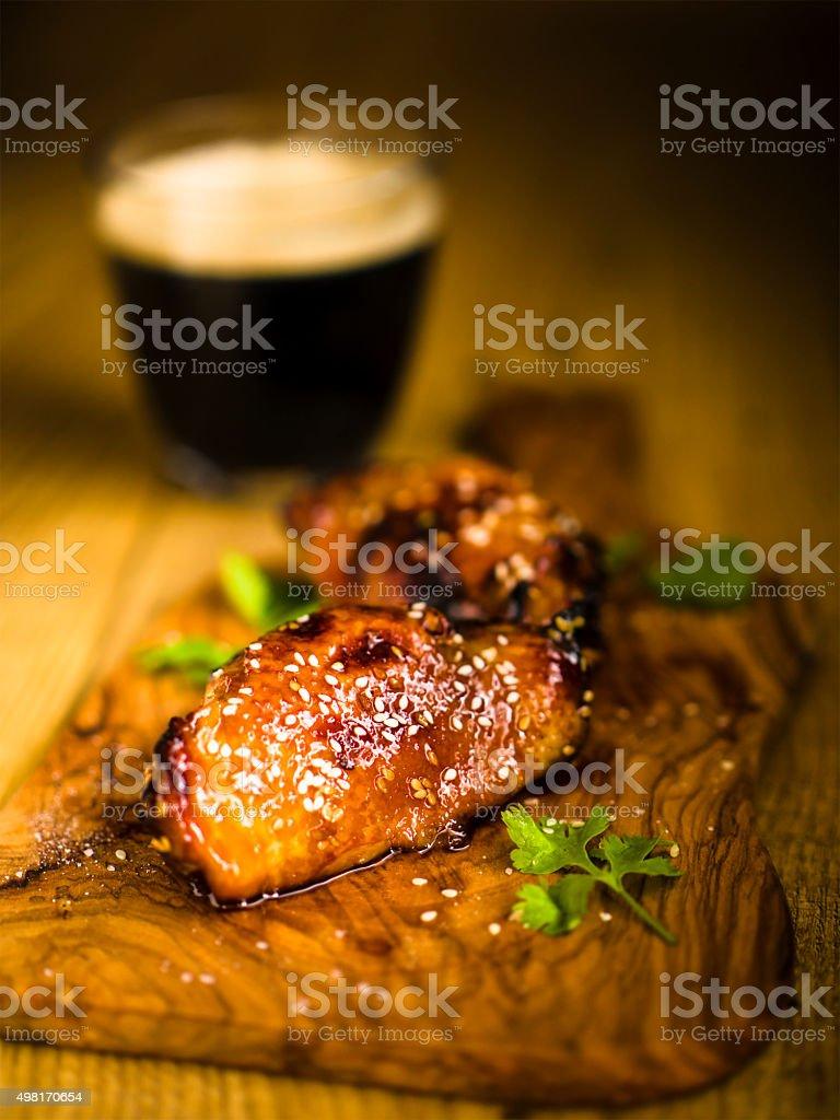 sticky chicken drumstick stock photo