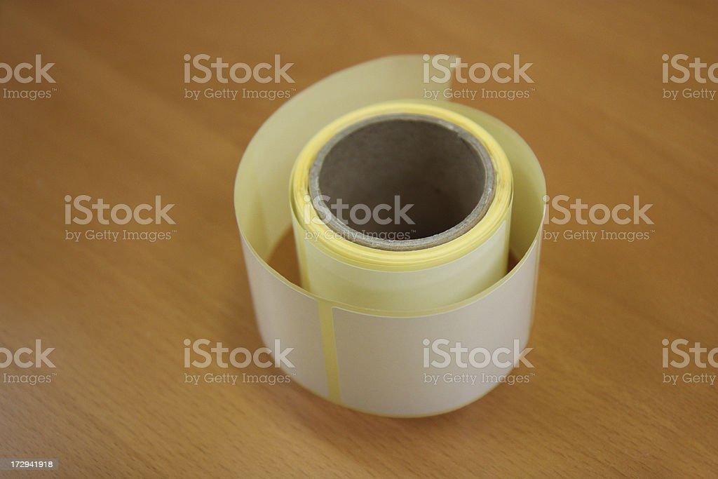 sticky label roll on desk