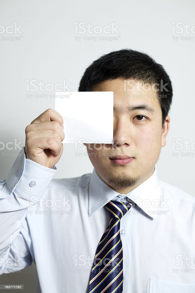 sticky note in businessman's hand royalty-free stock photo