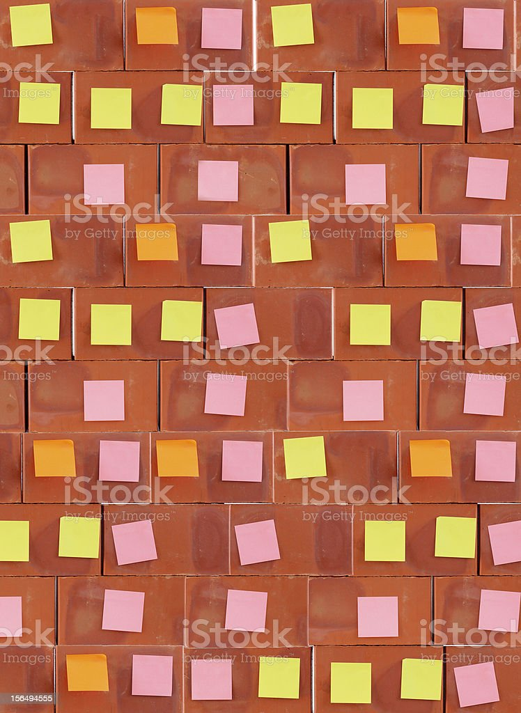 Sticky note on  brick wall royalty-free stock photo