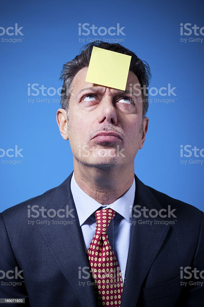 Sticky Note on Businessman's Head royalty-free stock photo