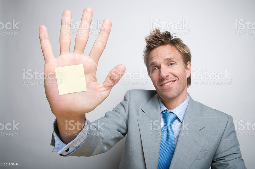 Sticky Note Reminder on Palm of Smiling Businessman royalty-free stock photo