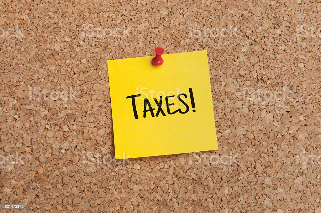 Sticky Note taxes due stock photo