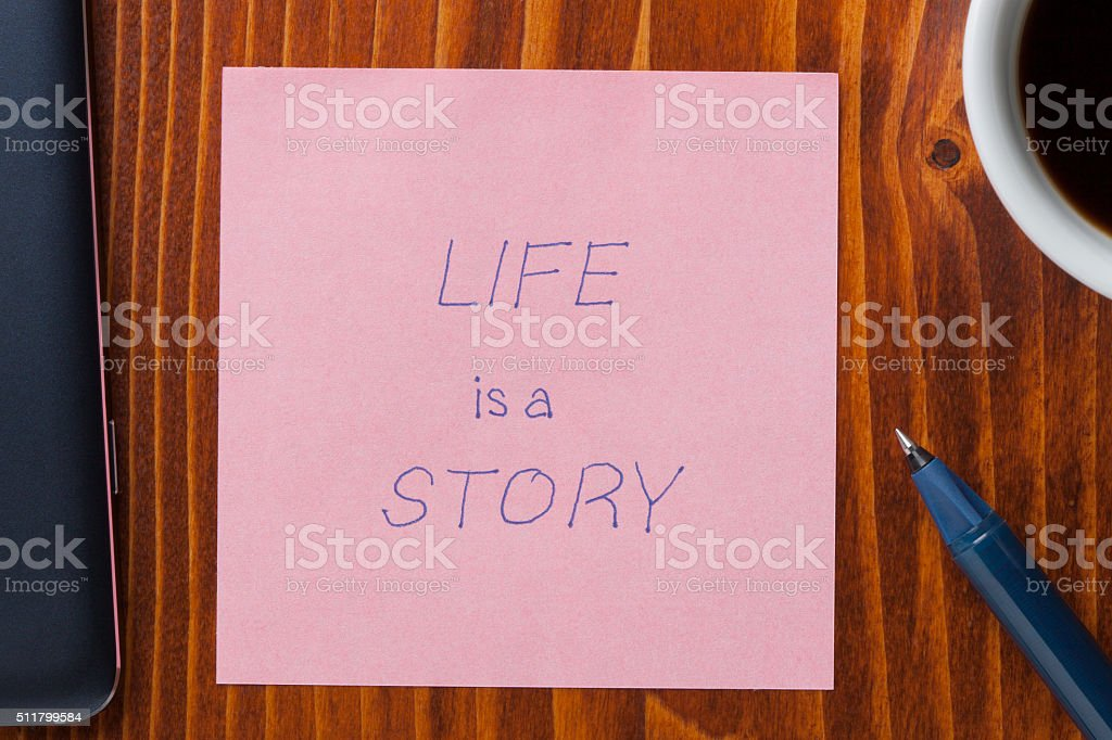 Sticky note with tex life is a story stock photo
