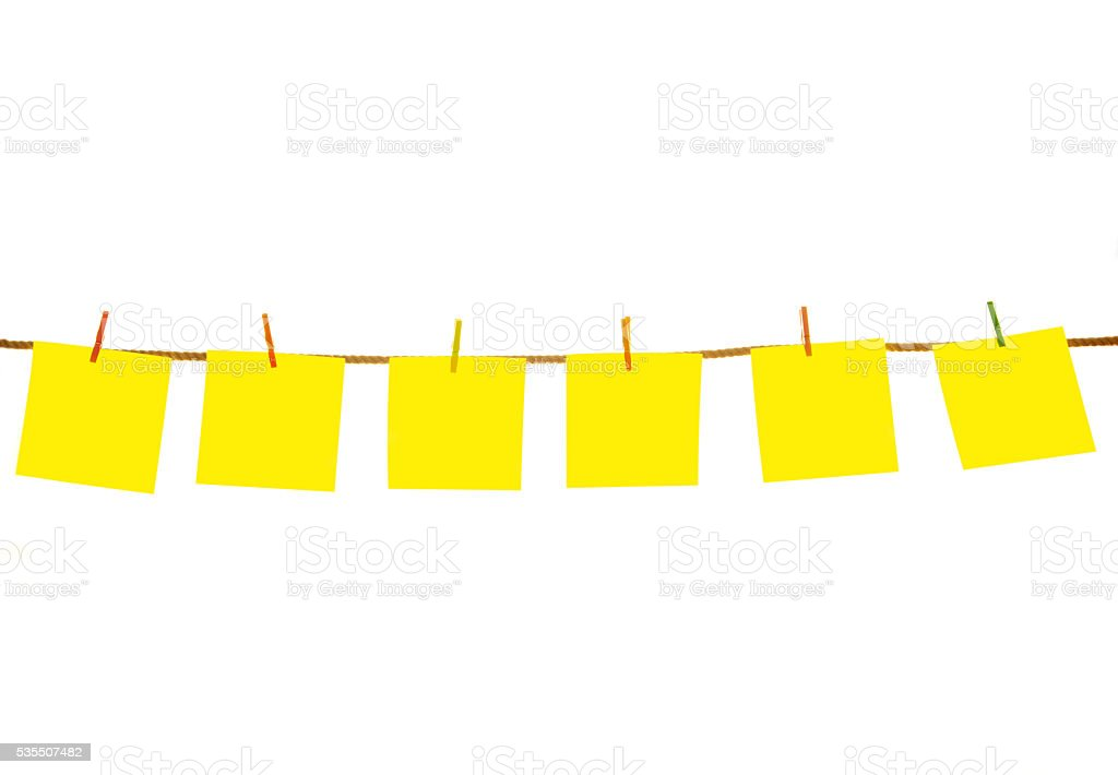 Sticky notes hanging on clothesline with clipping path stock photo