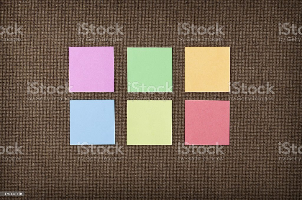 Sticky notes on fiberboard background royalty-free stock photo