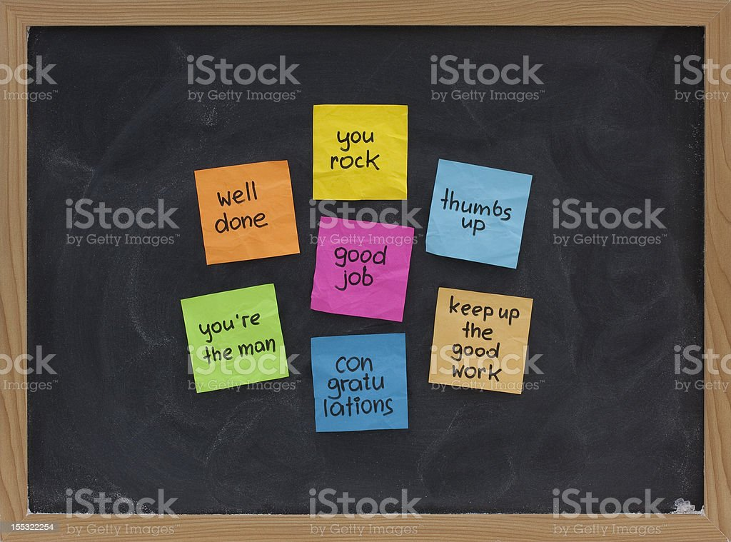 Sticky notes with compliments on blackboard stock photo