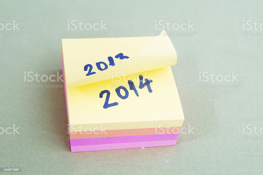 2014 - Sticky notes with old and new year stock photo