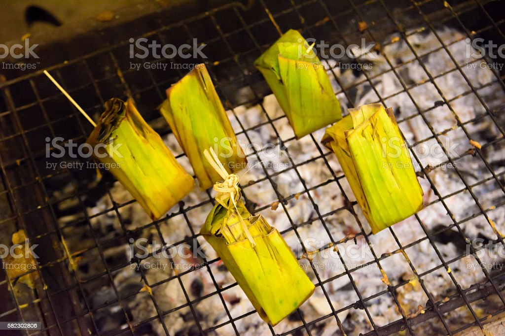 Sticky rice grill in market thailand stock photo