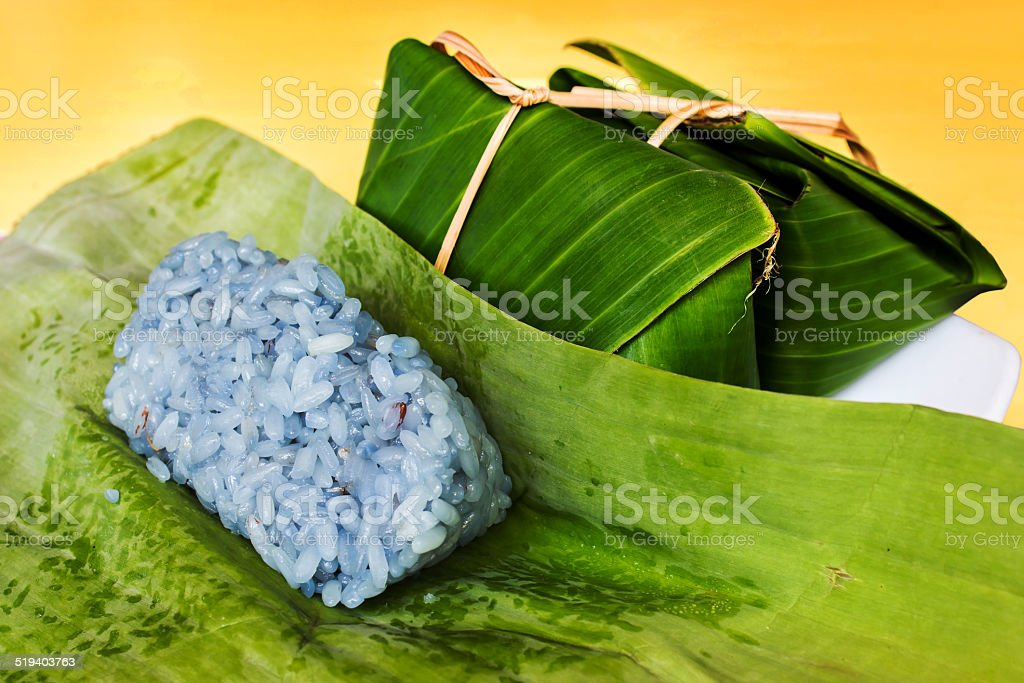 sticky rice in banana leaf stock photo