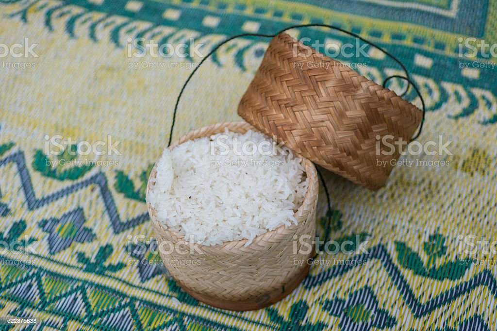 sticky rice in basket container bamboo stock photo