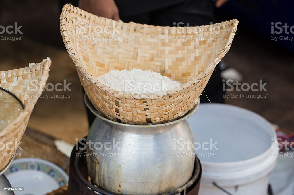 Sticky rice steam cooking process stock photo