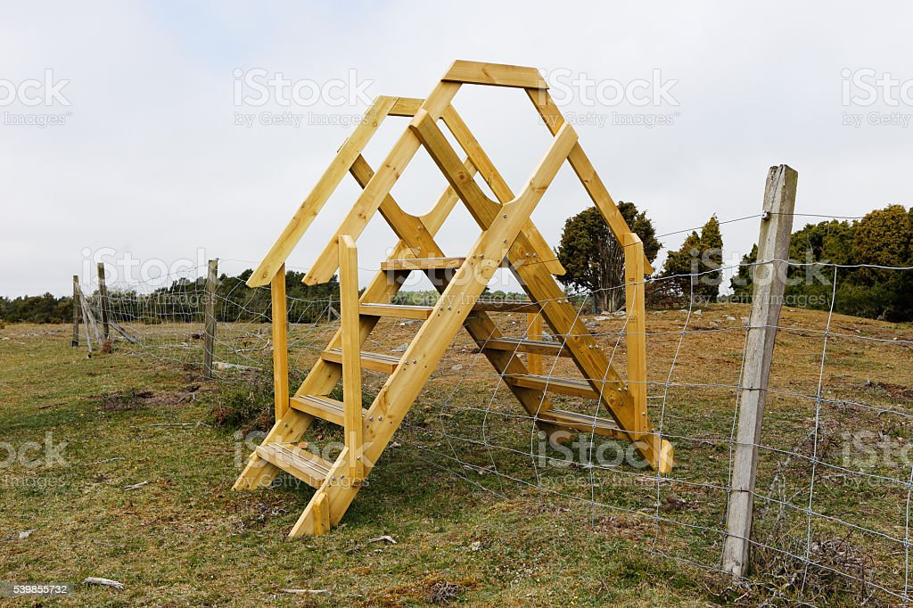 Stile over the fence stock photo