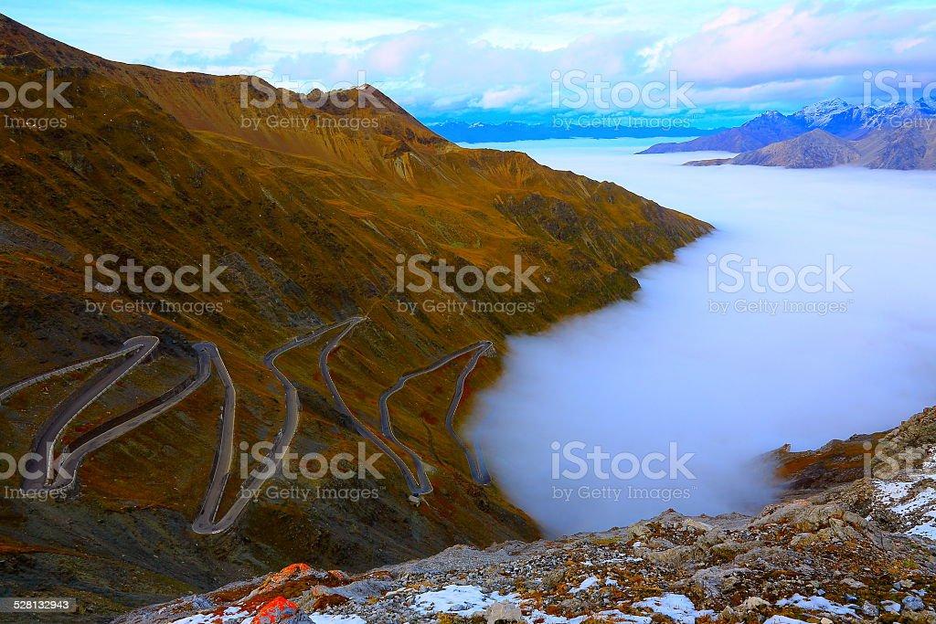 Stilfser Joch, Passo dello Stelvio, above clouds at sunrise, Italy stock photo