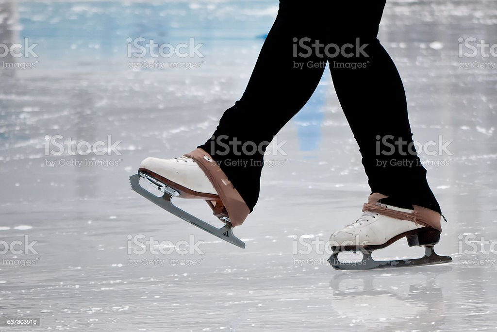 Still capture of recreational figure skater ice skates stock photo
