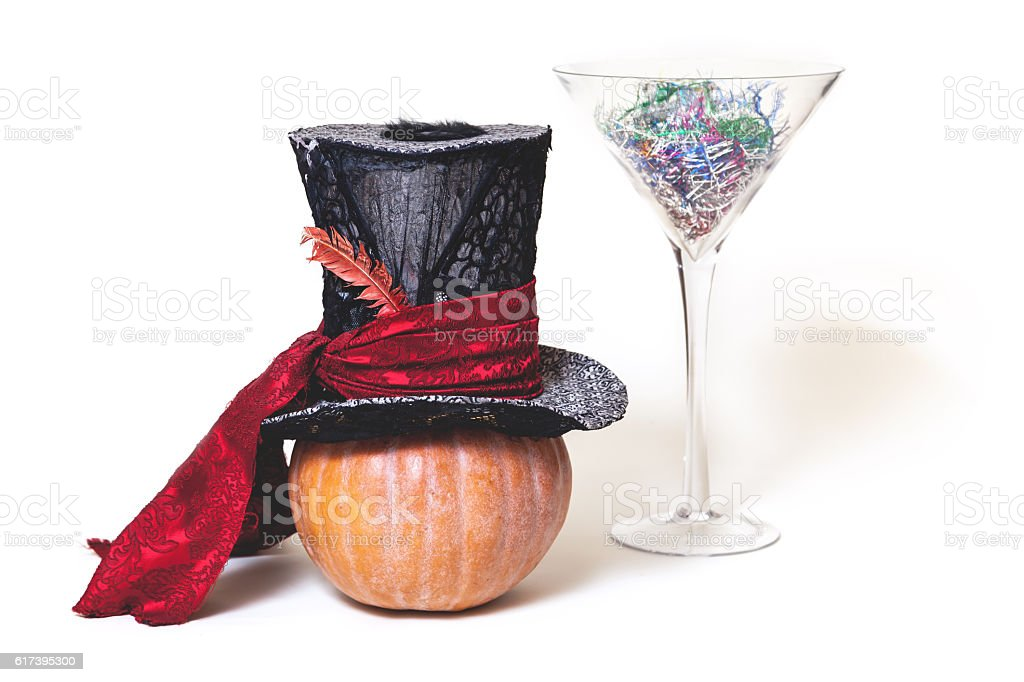Still Fabulous. Hat, pumpkin and huge glass on white background stock photo
