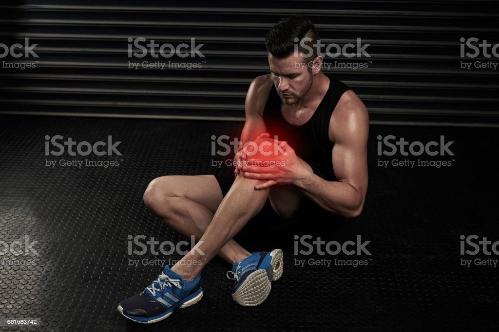 Still feeling some pain on his knee... stock photo