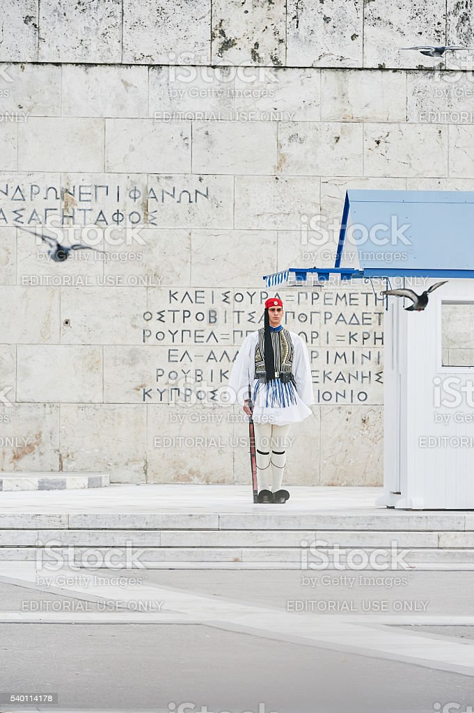 Still honor Evzones guards with peace pigeons stock photo