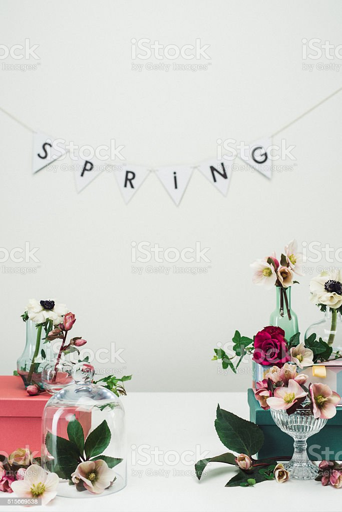 Still life arrangement of flowers and vases spring rose background stock photo