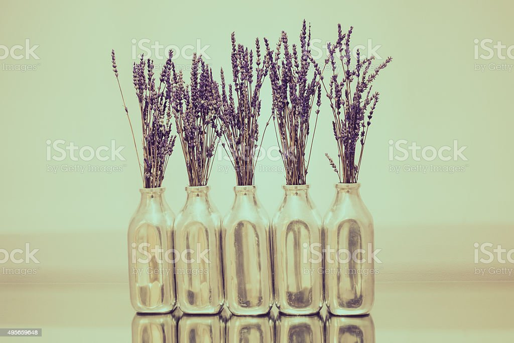 Still life Blossom Lavender in luxury bottle with clear wall. stock photo