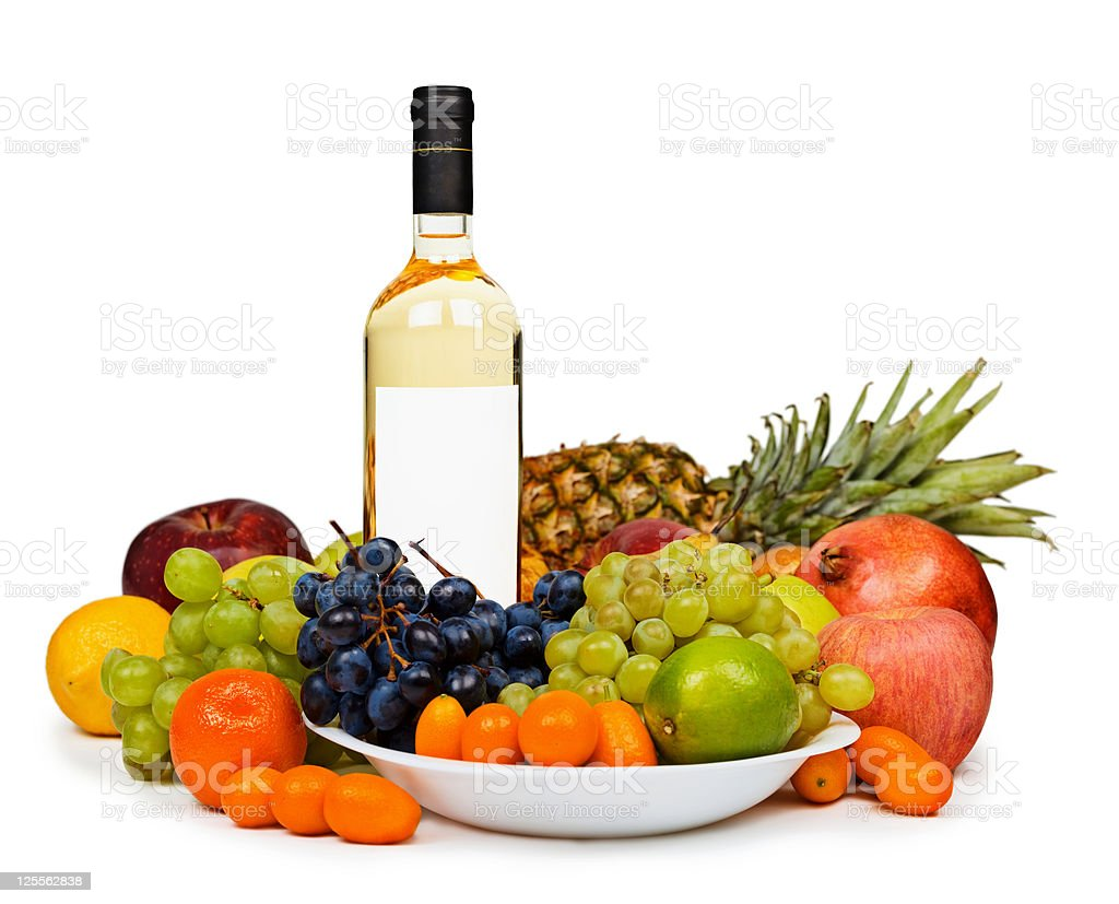 Still life - bottle of white wine among fruits royalty-free stock photo