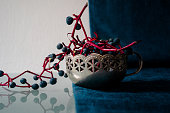 still life. bunches of wild grapes in a silver vase
