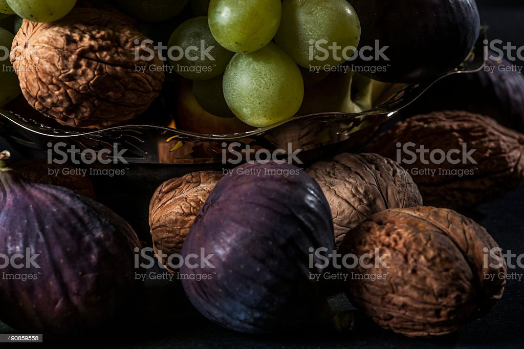 Still life figs,nuts and green grape stock photo