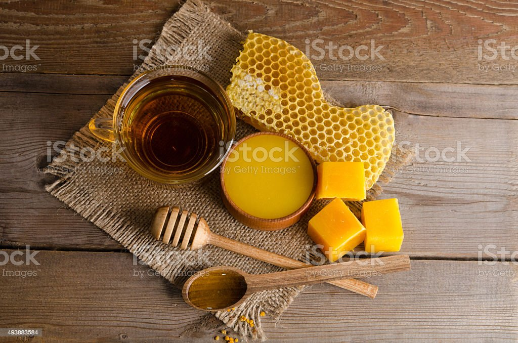 Still life from cup of tea, honey, wax and honeycombs stock photo