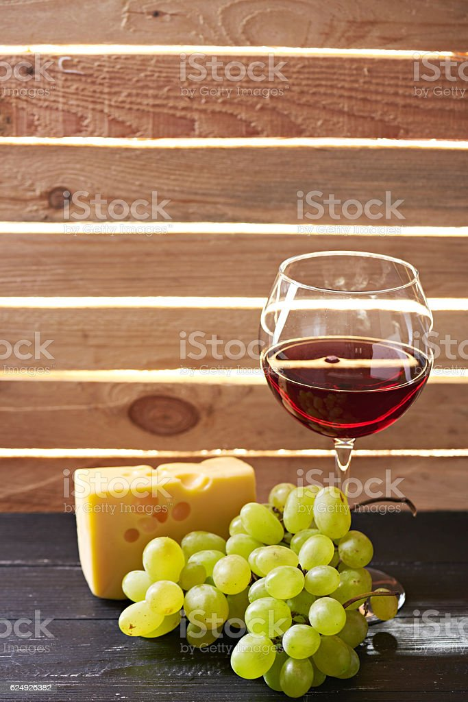 Still life glass of wine and grapes stock photo