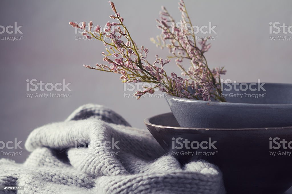 Still life gray vintage bowls with flowers horizontal stock photo