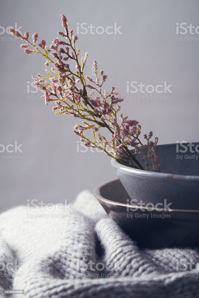 Still life gray vintage bowls with flowers stock photo