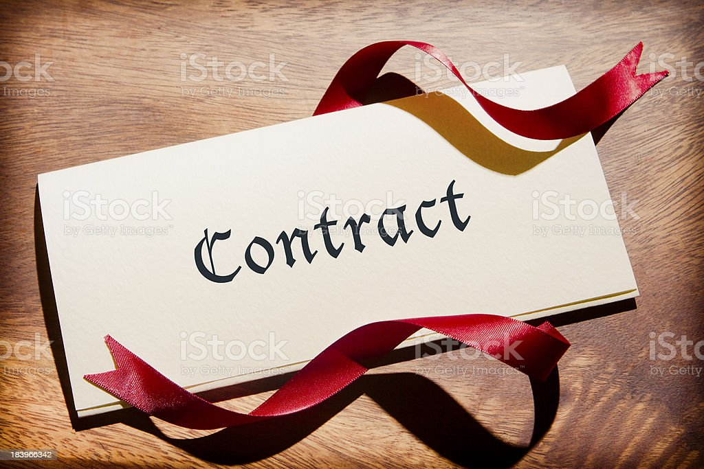 Still Life Of Contract Document On Wooden Desk stock photo