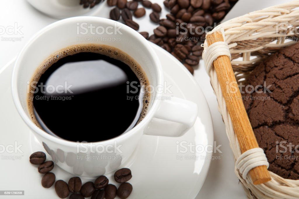 Still life of cup of coffee and chocolate cookies stock photo