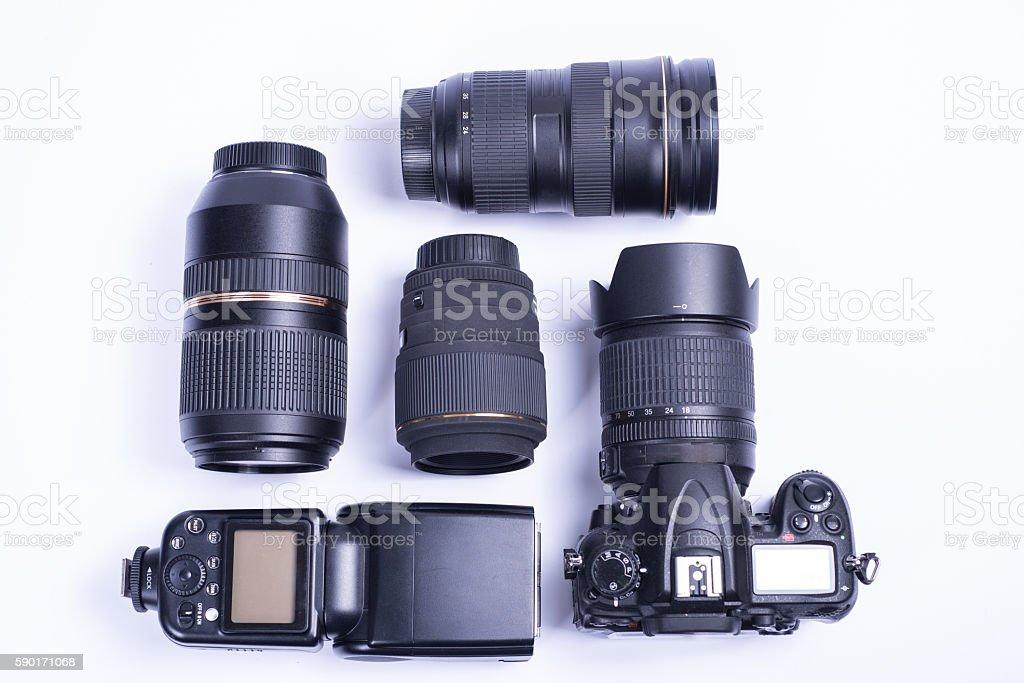 still life of dslr photo equipment on white background stock photo
