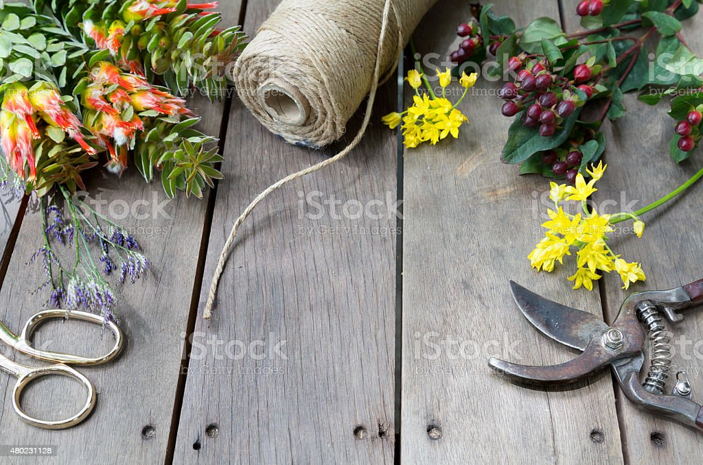 Still life of flowers and space concept on wooden table stock photo