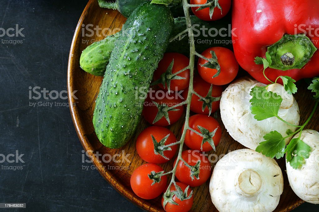 still life of fresh vegetables (tomatoes, mushrooms, peppers, cucumbers) royalty-free stock photo