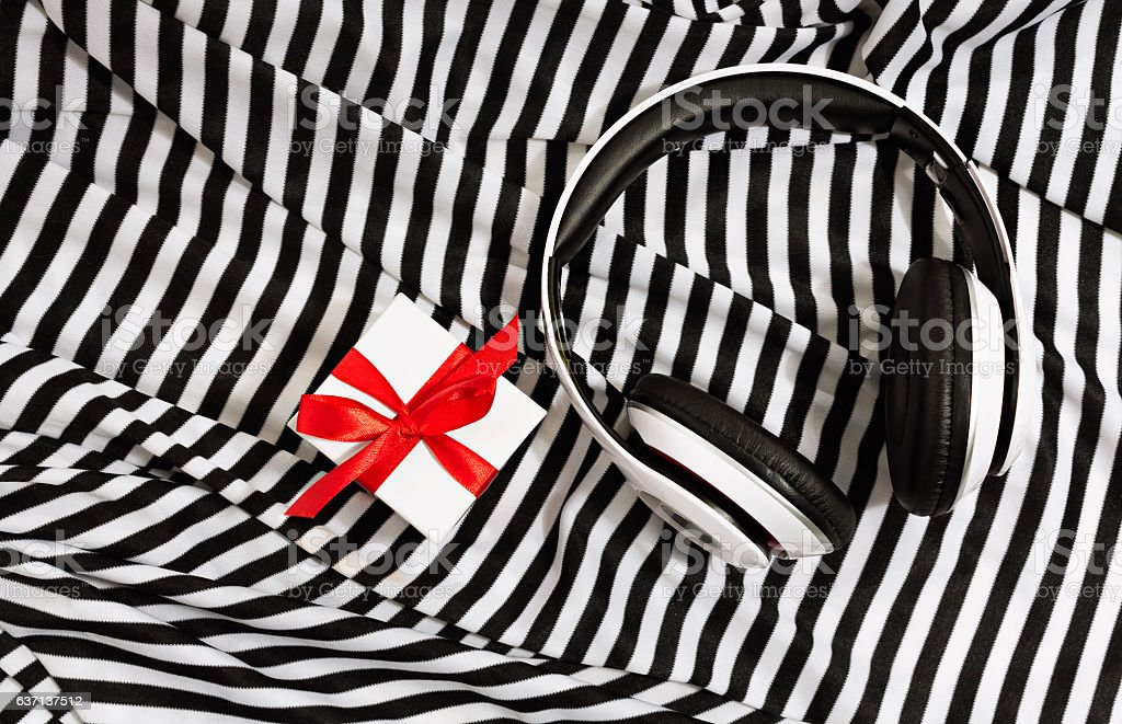 Still Life of Headphones and Gift Top View stock photo