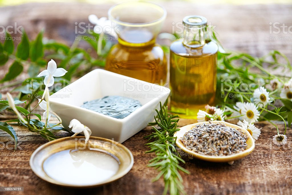 Still life of herbs, massage oil, mud mask, rosemary, salt royalty-free stock photo