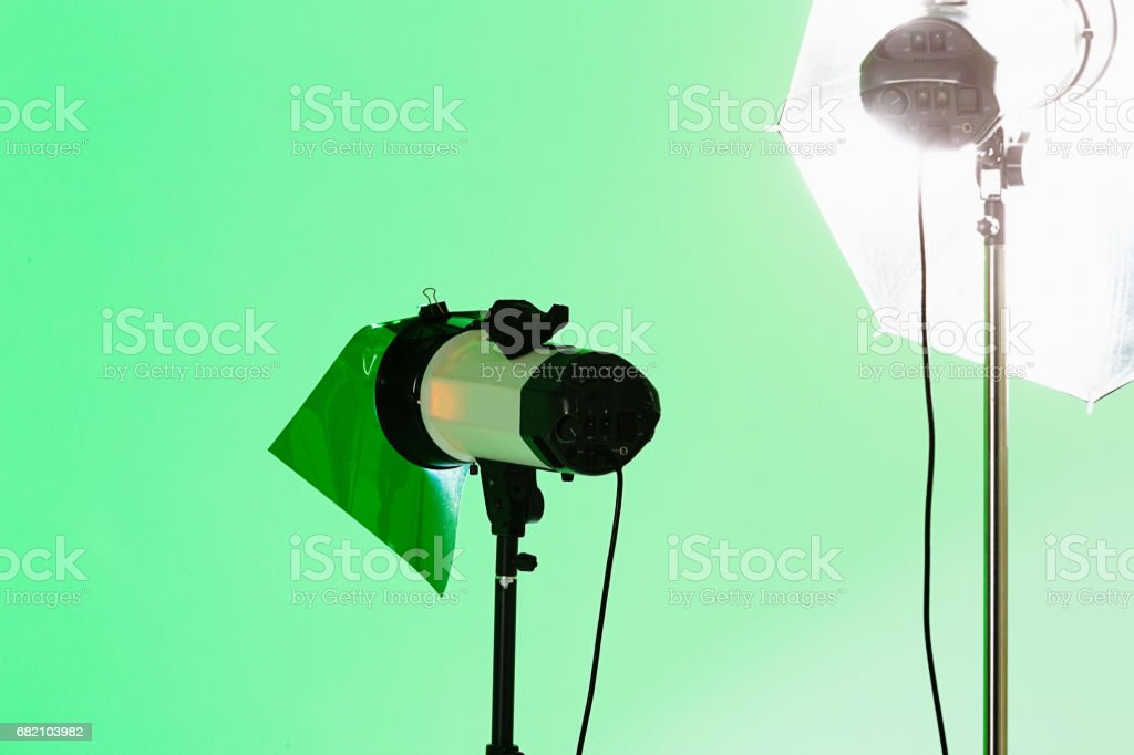 Various photographic lights, lit, shot against a green background...