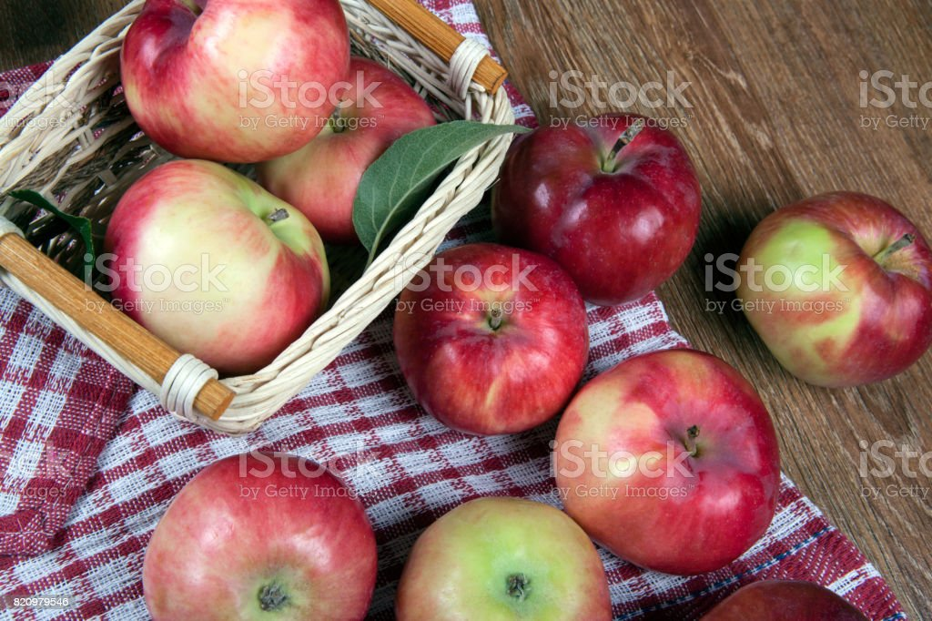 Still life of many apples on a napkin in the basket on a napkin close up stock photo