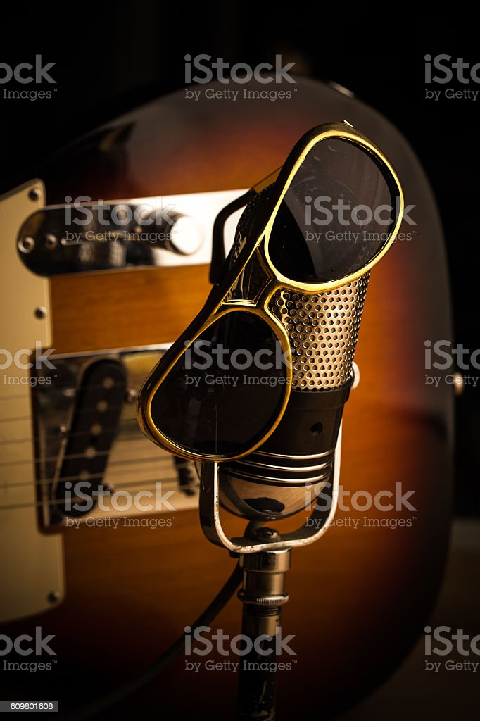 Still Life of Microphone and Guitar with Sunglasses stock photo