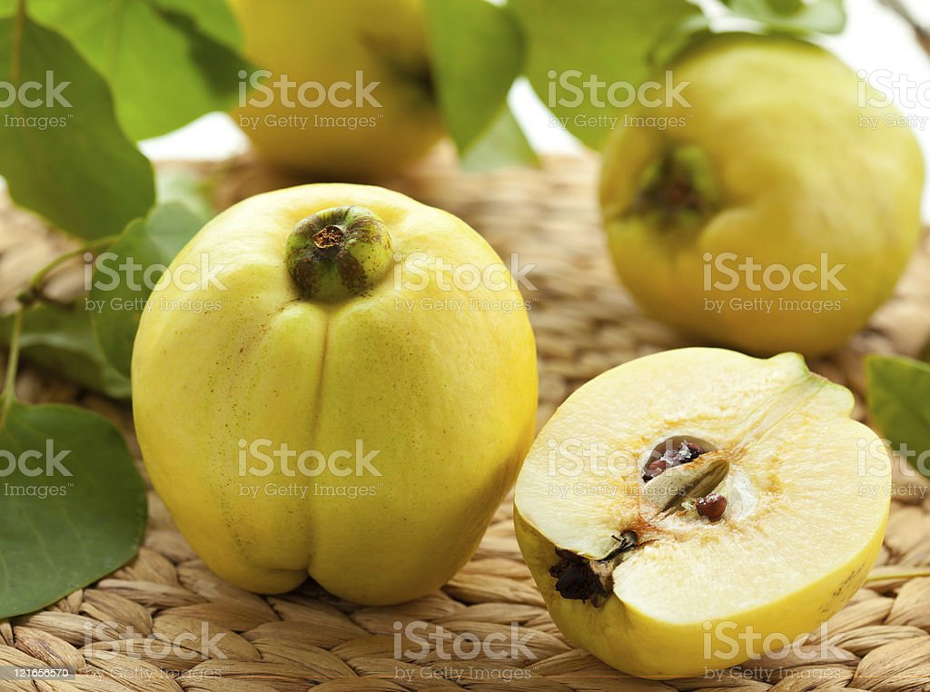 Still life of quinces sitting on a placement stock photo