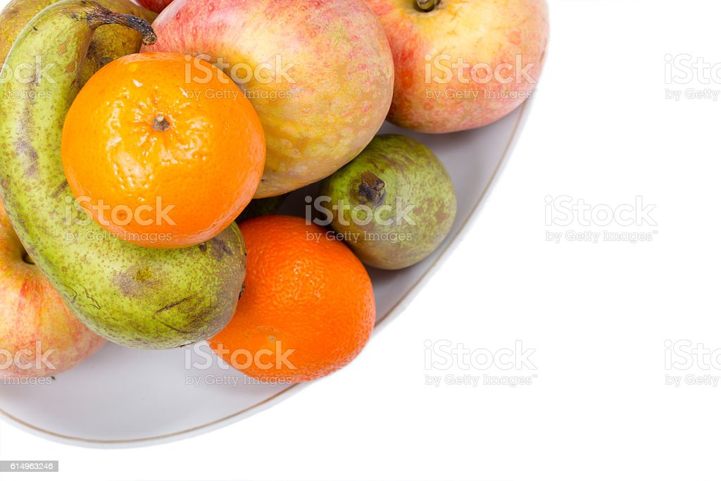 Still life of ripe fruit on a white background stock photo