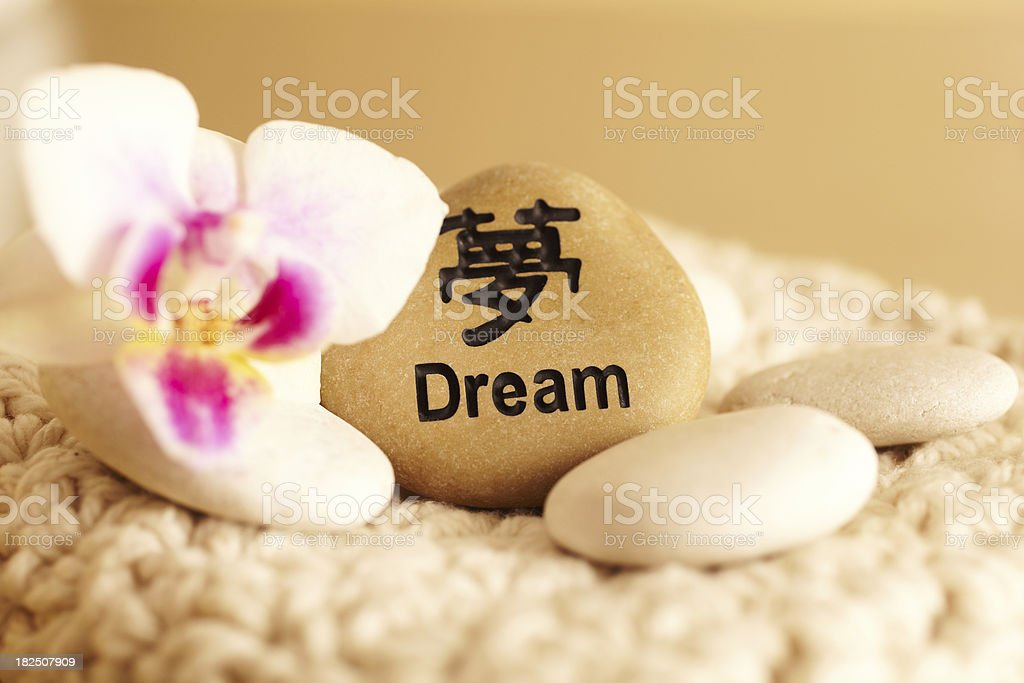 Still Life of rock with dream in Japanese script royalty-free stock photo