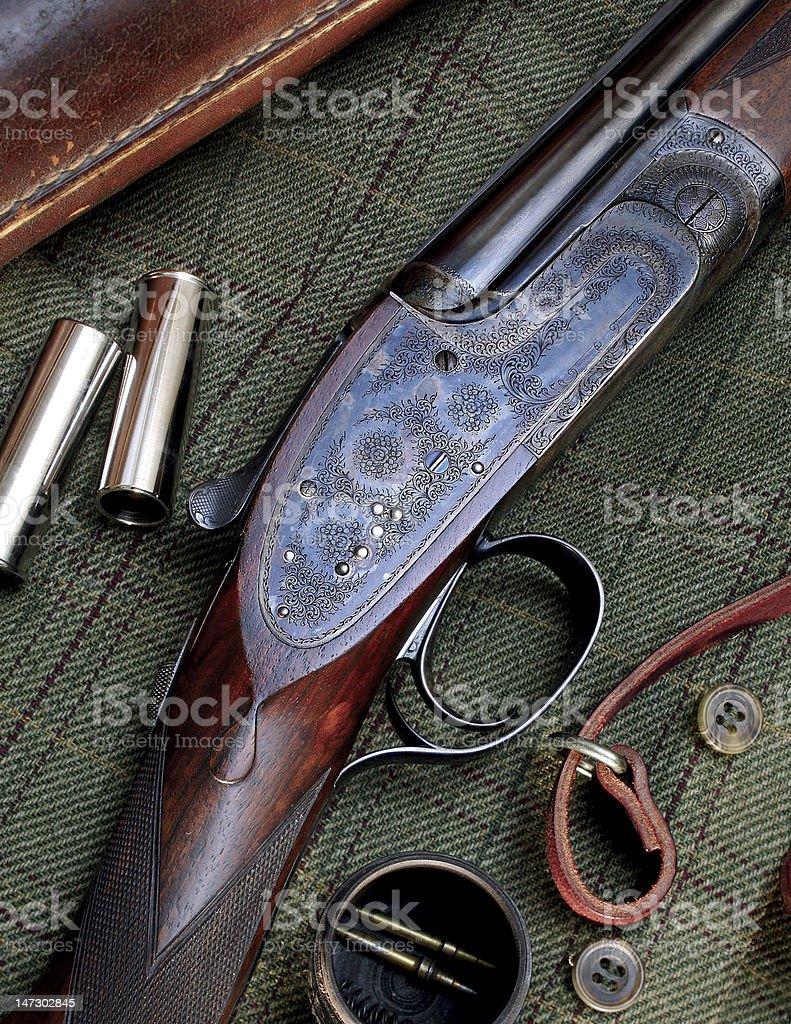 Still Life of Shotgun, Shells, and Jacket stock photo